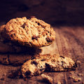 Chocolate cookies over wooden background in country style choco chip pile shot on table macro Stock Photo