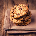 Chocolate cookies over wooden background in country style choco chip shot on coffee colored napkin closeup Stock Photo