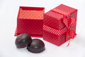 Chocolate cookies with red gift box with bow Stock Image