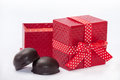 Chocolate cookies with red gift box with bow Royalty Free Stock Images