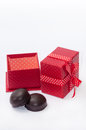 Chocolate cookies with red gift box with bow Stock Photography