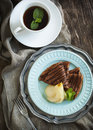 Chocolate crepes with poached pear in syrup Royalty Free Stock Photo
