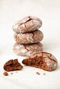 Chocolate crinkles cookies on a linen cloth shallow dof Royalty Free Stock Images