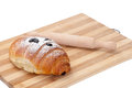 Chocolate croissant on a wooden board with rolling pin Stock Photography