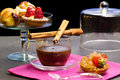Chocolate cup with fancy cakes delicious pastry Stock Photo
