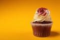 Chocolate cupcake with cream isolated on orange background Royalty Free Stock Photo