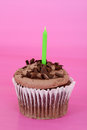 Chocolate cupcake focus on candle Stock Image