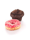 Chocolate cupcake pink donut against white background Royalty Free Stock Image
