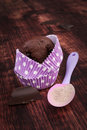 Chocolate cupcake in purple dotted paper baking form bar and baking mixture on wooden background baking cupcakes rustic Royalty Free Stock Photos