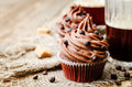 Chocolate cupcakes with chocolate frosting and chocolate chips the toning selective focus Royalty Free Stock Image