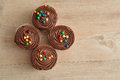 Chocolate cupcakes with chocolate frosting and decorated colorful candy Royalty Free Stock Image