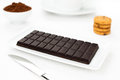 Chocolate dark tablet, cocoa, cookies white table Stock Images