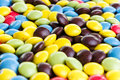 Chocolate dragees background focus in the center of colorful of sweets jelly beans Royalty Free Stock Images