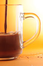Chocolate drinks in glass pour Stock Photo