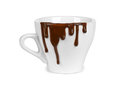 Chocolate drips on a cup isolated white Royalty Free Stock Images