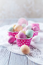 Chocolate easter eggs in muffin tins colorful arzipan Royalty Free Stock Photography