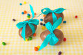 Chocolate Easter eggs over yellow tablecloth
