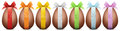 Chocolate easter eggs with ribbon bow on white backgrou isolated background Royalty Free Stock Images
