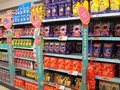 Chocolate easter eggs on sale rows of or candy shelves for in a store this is in the sainsbury store in bedford united kingdom Royalty Free Stock Photography
