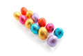 Chocolate easter eggs in tray colorful foil on white background Stock Images