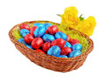 Chocolate easter eggs wicker basket Stock Photo