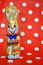Chocolate easter rabbit with red polka dots background Stock Photo