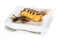 Chocolate eclairs with cream filling on a platter isolated Royalty Free Stock Photo