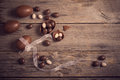 Chocolate eggs over wooden background easter Royalty Free Stock Image