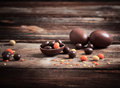 Chocolate eggs over wooden background easter Stock Images