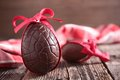 Chocolate eggs and red bow Royalty Free Stock Images