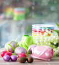 Chocolate eggs and spring flowers easter decoration Royalty Free Stock Photos