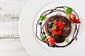 Chocolate fondant cupcake with strawberries Royalty Free Stock Photo