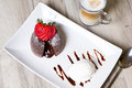 Chocolate fondant lava cake with strawberries and ice cream Royalty Free Stock Photo