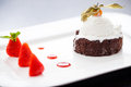 Chocolate fondant with vanilla ice cream and strawberry jam Stock Image