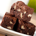 Chocolate fudge brownie with pecan and walnuts Stock Image