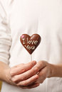Chocolate heart in the hands Stock Images