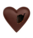 Chocolate heart pierced with a hole Royalty Free Stock Photo