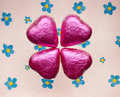 Chocolate hearts valentines day on defocused hand painted floral background Royalty Free Stock Image