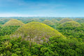 The chocolate hills of bohol island philippines are unique geological formations at they are covered in green grass that turns Stock Images