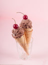 Chocolate ice cream in wafer cones standing in glass selective focus Royalty Free Stock Photo