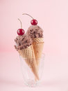 Chocolate ice cream in wafer cones standing in glass selective focus Stock Photo