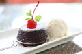 Chocolate lava cake with ice cream in close up Royalty Free Stock Photos