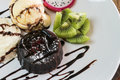 chocolate lava cake set served with ice cream vanila,wiped and m Royalty Free Stock Photo