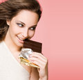 Chocolate loving beauty. Royalty Free Stock Photo