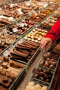 Chocolate market woman hand buying chocolates and chocolates Stock Image