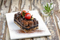 Chocolate moist cake on a wooden table Royalty Free Stock Photography