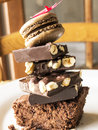 Chocolate mountain many varieties of brownie macaron and with nuts Stock Photo