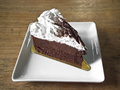 Chocolate mousse cake on wood background Royalty Free Stock Image