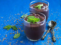 Chocolate mousse dessert in glasses decorated with mint Royalty Free Stock Photo