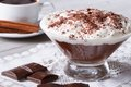 Chocolate mousse with whipped cream in a glass and coffee Royalty Free Stock Photo